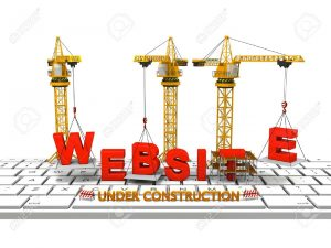 14712384-Cranes-building-a-website-on-a-computer-keyboard-concept-of-website-under-construction-Stock-Photo